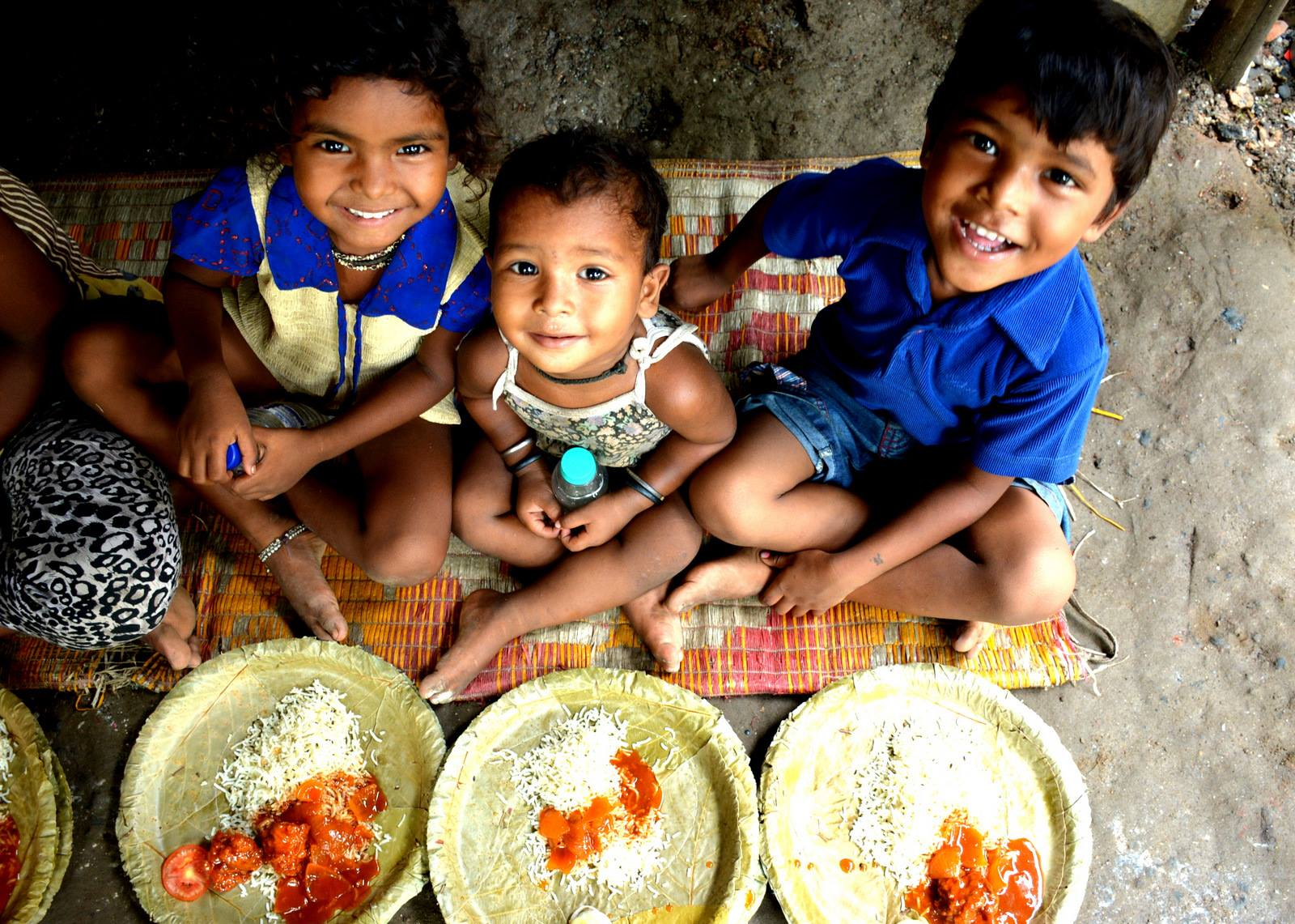 Children in West Bengal happy after getting a free meal from FEED