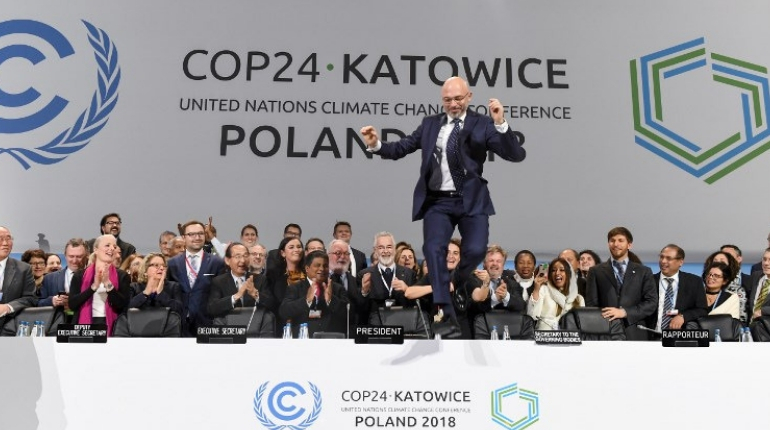COP24 president Michal Kurtyka jumps at the end of the final session of the COP24 summit on climate change in Katowice, southern Poland.