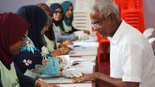 Maldivian joint opposition presidential candidate Ibrahim Mohamed Solih prepares to cast his vote at a polling station during the presidential election in Male, Maldives