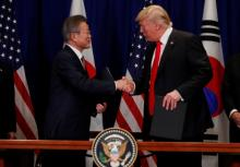South Korean President Moon Jae-in shakes hands with US President Donald Trump after they signed the U.S.-Korea Free Trade Agreement on the sidelines of the 73rd United Nations General Assembly in New York, US.