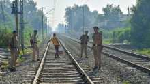 Railway protection Force personnel guard a railway crossing near the accident site in Amritsar.