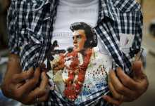 An Elvis Presley fan shows his T-shirt at the four-day Collingwood Elvis Festival in Collingwood, Ontario July 25, 2015.