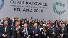 Heads of the delegations react at the end of the final session of the COP24 summit on climate change in Katowice, southern Poland.