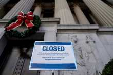 A sign declares the National Archive is closed due to a partial federal government shutdown in Washington, US, December 22, 2018.