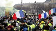 Protesters wearing yellow vests take part in a demonstration by the 'yellow vests' movement, in Paris, France.