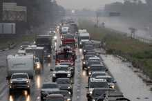 Traffic moves bumper to bumper along I-10 west as residents evacuate before the arrival of Hurricane Delta in Westlake, Louisiana