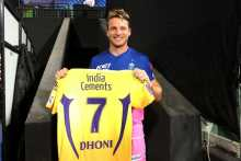 'Prized possession': Jos Buttler poses with Dhoni's jersey after downing CSK