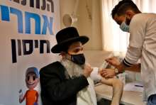 An Ultra-Orthodox Jewish man gets vaccinated against the COVID-19 coronavirus at Clalit Health Services center in the ultra-Orthodox city of Bnei Brak