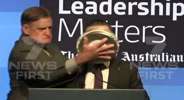 Qantas CEO has pie shoved in face