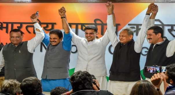 Rajasthan Congress President Sachin Pilot and senior party leader Ashok Gehlot with KC Venugopal (2nd L), Avanish Pandey (L) and Jitendra Singh (R) at a press conference at AICC headquarters in New Delhi, Friday, Dec. 14, 2018.