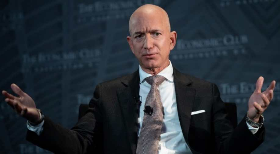 Amazon's Bezos says National Enquirer tried to blackmail him over 'intimate photos'