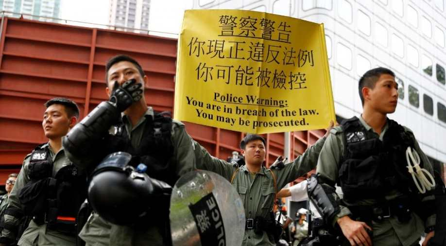 Hong Kong police fire tear gas, water cannon to disperse